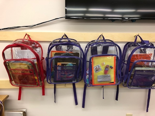 "Our interactive literacy backpack collection is growing! Exploring, Holidays, New Baby, Dinosaurs!!! These are the hottest"" item in the Library!"